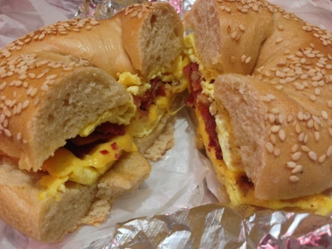 Breakfast bagel with eggs and bacon
